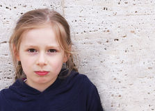 Pretty little  girl. On stone wall  background Stock Photo