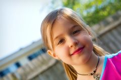 Pretty Little Girl. Head and shoulders portrait of a pretty little girl in natural light royalty free stock photography