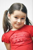 Pretty Little Girl. Posing over white background Stock Photos