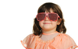 Pretty the little girl in abstract sun glasses Royalty Free Stock Photos