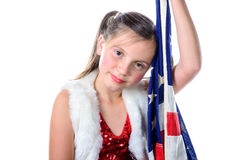 A pretty little girl with a american flag Royalty Free Stock Photo