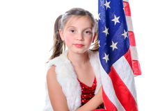 A pretty little girl with a american flag Stock Photos