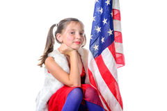 A pretty little girl with a american flag Stock Image