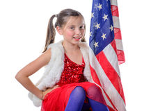 A pretty little girl with a american flag Royalty Free Stock Photography
