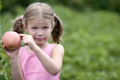 Pretty Little girl with a Apple. Stock Images