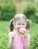 Pretty Little girl with a Apple. Royalty Free Stock Images