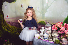 Pretty little girl as Alice in Wonderland Royalty Free Stock Photo