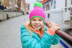Pretty little girl in autumn city Stock Photo
