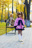 Pretty little girl in autumn park. Stock Image
