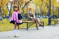 Little girl and her mother in autumn park Royalty Free Stock Photography