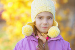 Pretty little girl in autumn park Royalty Free Stock Photo