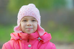 Pretty little girl in autumn park Royalty Free Stock Image