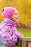Pretty little girl in autumn park Royalty Free Stock Images