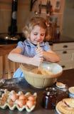 Pretty little girl baking Stock Photos