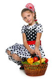 Pretty little girl with a basket of vegetables Stock Photo