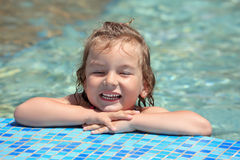 Pretty little girl bathe in pool, closed eyes Royalty Free Stock Image