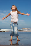 Pretty little girl on the beach. Little girl enjoying the sun on the meach Royalty Free Stock Photography