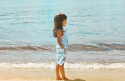 Pretty little girl on the beach near sea. Summer, vacation, travel - concept Royalty Free Stock Photos