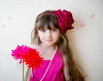 Pretty little girl in beautiful dress with flowers Stock Images