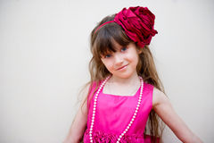 Pretty little girl in beautiful pink dress Stock Photos