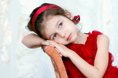 Pretty little girl in beautiful red dress Stock Photo