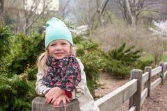 Pretty little girl at beauty autumn landscape Stock Photos