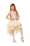 Pretty little girl in a beige dress Royalty Free Stock Image
