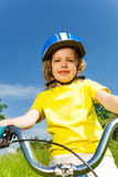 Pretty little girl on a bicycle Stock Photo