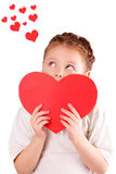 Pretty little girl with a big red heart for Valentine's Day Royalty Free Stock Photos
