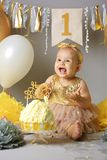 Pretty little girl with birthday cake. Cute baby on her birthday party. Cake Smash stock images
