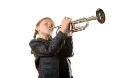 A pretty little girl with a black jacket plays the trumpet Royalty Free Stock Photo