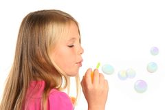 Pretty Little Girl Blowing Bubbles Stock Photo