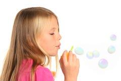 Pretty Little Girl Blowing Bubbles Stock Photo