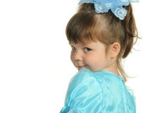 Pretty the little girl in a blue dress Stock Image