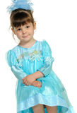 Pretty the little girl in a blue dress Stock Images
