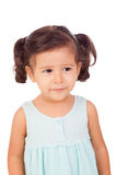 Pretty little girl with blue dress looking at side i Stock Photos
