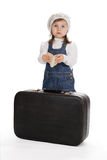 Pretty little girl with book and suitcase Royalty Free Stock Photo