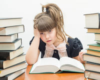 Pretty little girl with books Royalty Free Stock Photography