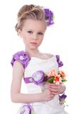Pretty little girl with bouquet Stock Photos