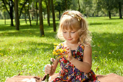Pretty little girl with bouquet of flowers Stock Images