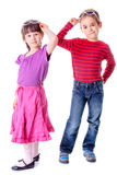 Pretty little girl and boy in studio Royalty Free Stock Photos