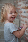 Pretty Little Girl by Brick Wall Stock Photography