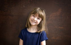 Pretty little girl with bright smil. Portrait of a pretty little girl with bright smile stock photo
