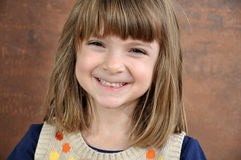 Pretty little girl with bright smil. Portrait of a pretty little girl with bright smile royalty free stock image