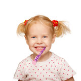 Pretty little girl brushing teeth. Royalty Free Stock Photography