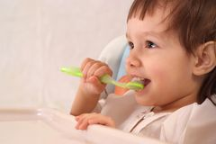 Pretty little girl brushing teeth Stock Photography