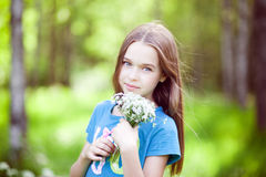 Pretty little girl with a bunch of flowers Royalty Free Stock Images
