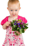 Pretty little girl with a bunch of garden flowers Stock Photography