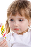 Pretty little girl with a candy Royalty Free Stock Images