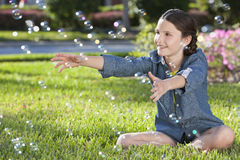 Pretty Little Girl Child Playing & Blowing Bubbles Stock Photos